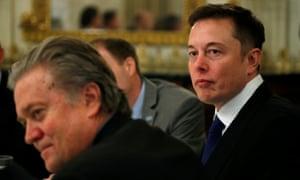 Tesla and SpaceX CEO, Elon Musk (R), sitting beside senior Trump adviser, Steve Bannon.