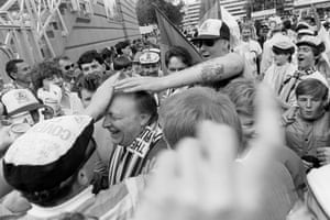 Labour leader Neil Kinnock, sporting a Tottenham Hotspur scarf, is swamped by enthusiastic Coventry City fans ahead of the 1987 Cup Final.