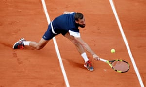 Benoit Paire stretches for a shot as his opponent Pierre-Hugues Herbert gets in the driving seat.