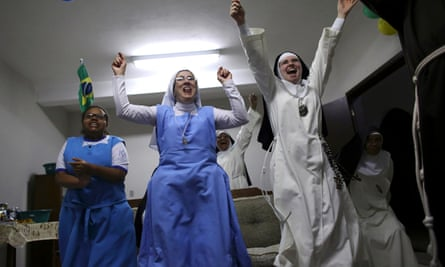 Brazilian nuns celebrate during the 2014 World Cup.