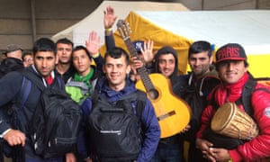Calais camp clearance: Nine men from one village. Majit Nurzei is pictured on the far right, with the drum.