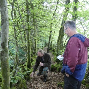 The Bulworthy Project's co-owner, Pete, giving Dixe a tour of the wood, Devon, UK.