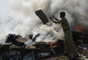 Agartala, India. Police incinerate about 6,000kg of seized cannabis, which the authorities say is worth about 30m rupees (£330,000)