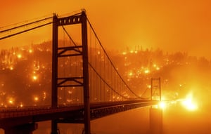 Embers light up a hillside behind the Bidwell Bar Bridge as the Bear Fire burns in Oroville. The blaze spread at a critical rate as winds buffeted the region.Wednesday, 9 September 2020, in Oroville, California.