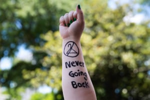 """Melissa Simpson holds up her arm with """"Never Going Back"""" written on it during a protest against recently passed abortion ban bills at the Georgia State Capitol building, on May 21, 2019 in Atlanta, United States."""