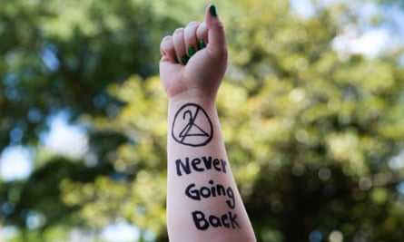 An activist holds up her arm during a protest against recently passed abortion ban bills at the Georgia State Capitol building.