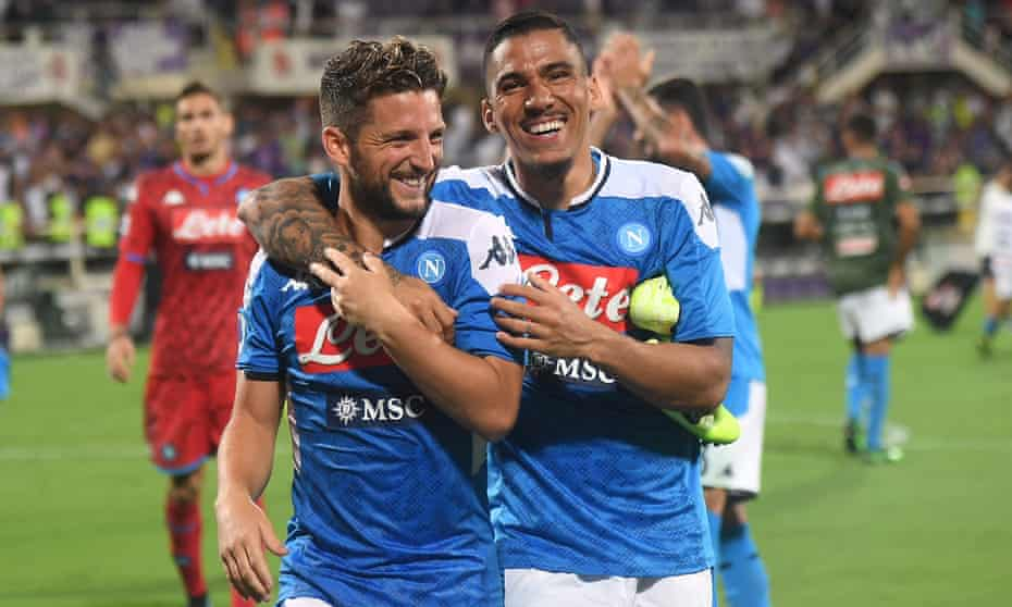 Napoli's Dries Mertens and Allan celebrate after their wild win at Fiorentina.