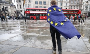 A demonstrator wrapped in a European flag leaves an anti-Brexit protest in Trafalgar Square in London
