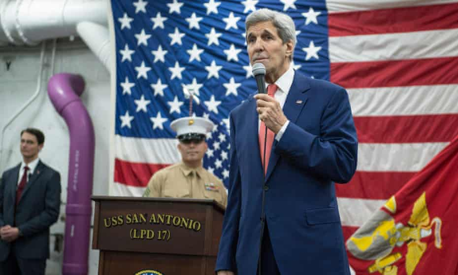 John Kerry addresses guests aboard the USS San Antonio. The US secretary of state is quoted as saying that any agreement at the Paris climate talks would not be a treaty.