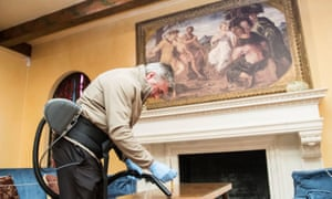 Paul Fretwell cleans the Drawing Room at Eltham Palace in London, as they prepare to reopen to the public following the further easing of lockdown restrictions in England.
