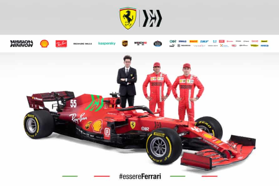 Charles Leclerc and Carlos Sainz with Ferrari's team principal, Mattia Binotto and the new SF21 Scuderia Ferrari.