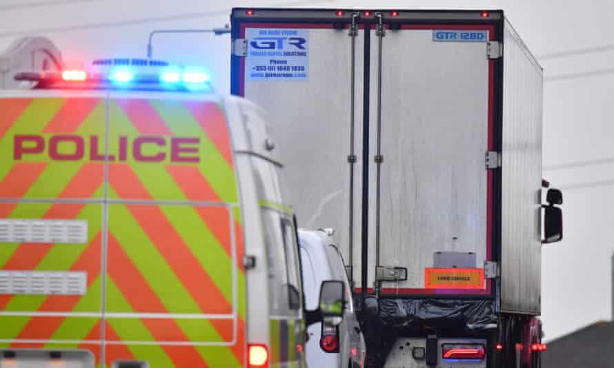 Police drive away the lorry