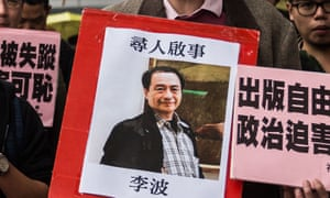 A protestor holds up a missing person notice for Lee Bo, one of five Hong Kong booksellers from the same Mighty Current publishing house to go missing at the hands of the Chinese.