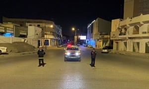 Police officers stand in the middle of the road during a curfew, imposed as part of precautionary measures against coronavirus, in Misrata, Libya March 22, 2020.