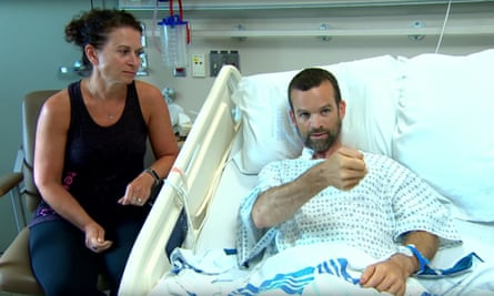 Colin Dowler in hospital next to his wife Jen. Dowler was mountain-biking at the time of incident.
