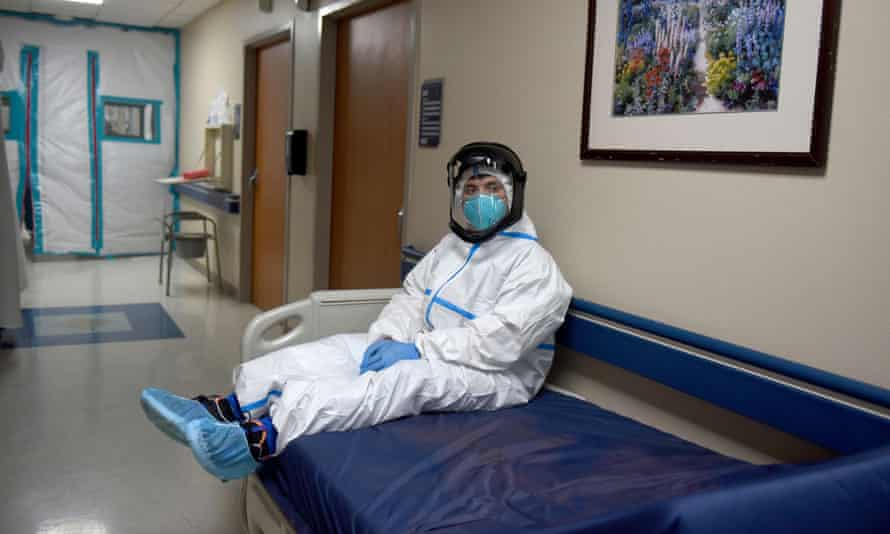 Gabriel Cervera briefly rests on an empty hospital bed in the coronavirus unit at United Memorial Medical Center in Houston, Texas in December 2020.
