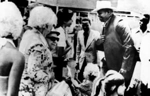 Ugandan president Idi Amin (wearing hat) talks to hostages released after the raid on Entebbe airport in July 1976