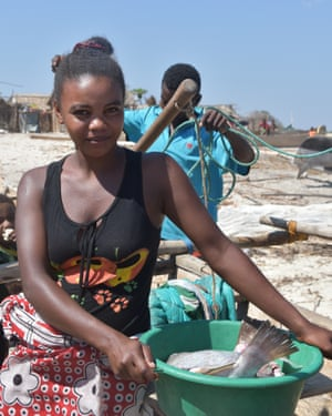 A woman with a fresh catch on a beach in Madagascar