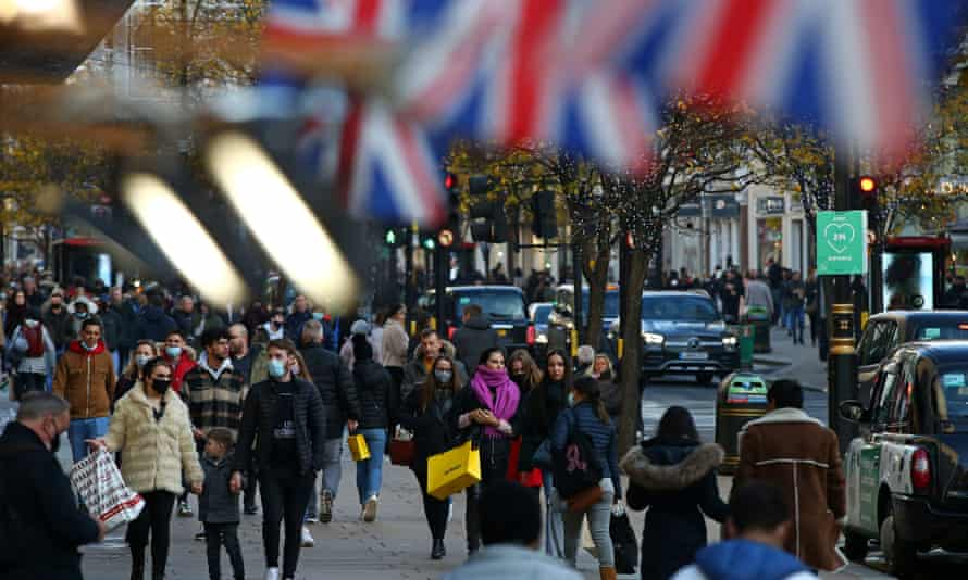 Shoppers walk along Oxford Street in central London.