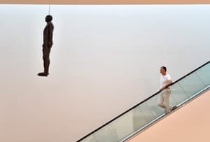 Artist Antony Gormley poses next to his artwork Object, 199 at the National Portrait Gallery in Londonon 7 September