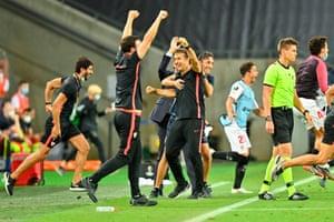 Sevilla's Spanish coach Julen Lopetegui (C) and staff celebrate.