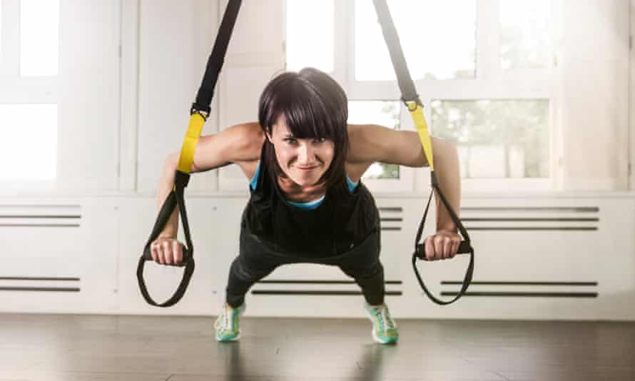 A woman doing suspension training