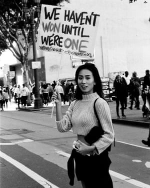 A woman crosses the street during a women's march in Los Angeles.