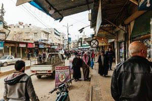 People walking in a market in the centre of Idlib.