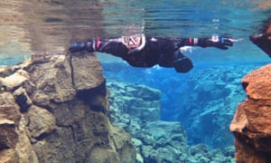 Kim-Joy swimming in the Silfra fissure – between the North American and Eurasian tectonic plates.