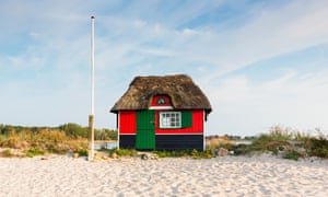 Thatched-roof beach hut at a grass covered sand dune by the Baltic Sea, Aero Island, Denmark.