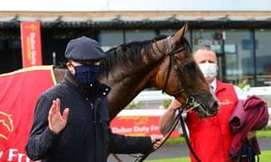 Aidan O'Brien with Santiago, winner of the Irish Derby at The Curragh on Saturday.