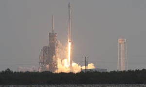 The SpaceX Falcon 9 rocket launches from its pad at the Kennedy Space Center.
