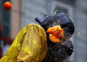 An orange explodes upon impact with a participant