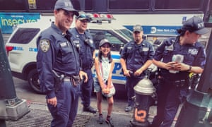 Little girl with four cops and a cop car Manhattan