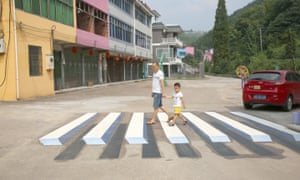 3D painting of a pedestrian crossing in Luoyuan village of Pujiang county, China, photographed in August 2015.