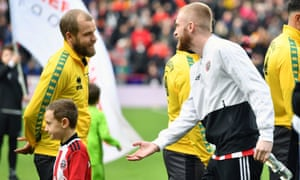 Norwich City's Teemu Pukki (left) greets Sheffield United's Oliver McBurnie ahead of the match at Bramall Lane, Sheffield, on 7 March.