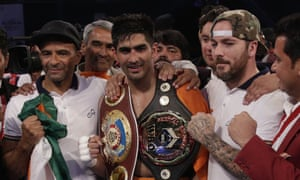 Vijender Singh with his two title belts after the match in Mumbai on Saturday.