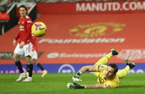 Southampton keeper Alex McCarthy saves from Bruno Fernandes of Manchester United.