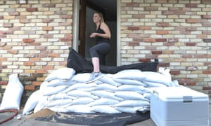Lacey Williams leaves her home in Houston, Texas, as Hurricane Harvey bears down on the state. Some officials have spoken of their concern that not as many people are leaving their homes as have done during previous extreme weather conditions