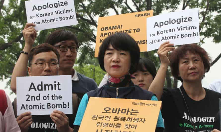 South Korean survivors of the Hiroshima bombing and supporters stage a rally demanding a public apology from Obama.