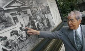 Sunao Tsuboi on Miyuki Bridge, where he was photographed three hours after the bombing of Hiroshima.