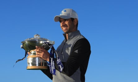 Aaron Rai shows off the Scottish Open trophy after beating Tommy Fleetwood on the first play-off hole at the Renaissance club.