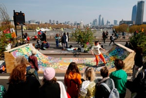 A man skateboards on a temporary ramp during the demonstration on Waterloo Bridge