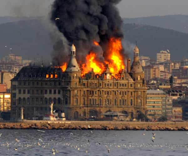 The blaze that engulfed the roof of Istanbul's historic Haydarpasa train station building on the Asian side of the city of Istanbul, Turkey is seen from the Bosporus on Sunday, Nov. 28, 2010. Firefighters battled a blaze that engulfed the roof of Istanbul's historic Haydarpasa train station building during restoration work Sunday, authorities said.(AP Photo)