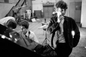 John Lennon plays harmonica