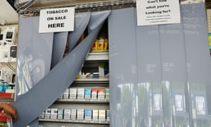Screens covering tobacco products at a shop in London.