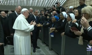Pope Francis joking with a nun as he arrives for the general audience at the Vatican.