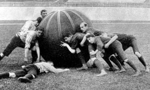 A player is floored as his team-mates wilt under the pressure of a 50lb ball shoved by their more powerful opponents in one of the first pushball games in Britain, in Crystal Palace.