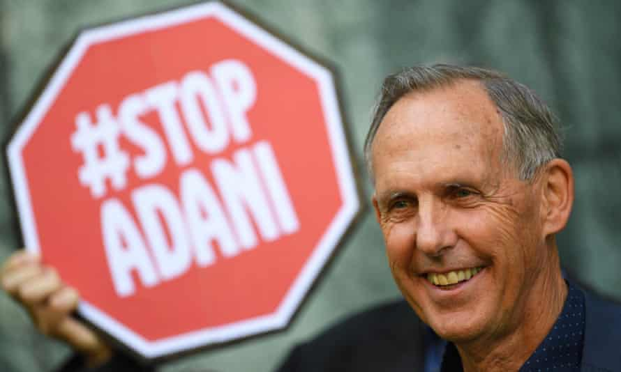 """Former Greens senator Bob Brown in front of a """"Stop Adani"""" sign in Canberra in 2017."""
