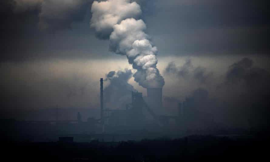 Vapour clouds emerging from an industrial plant and a coal-fired power station in Duisburg, Germany
